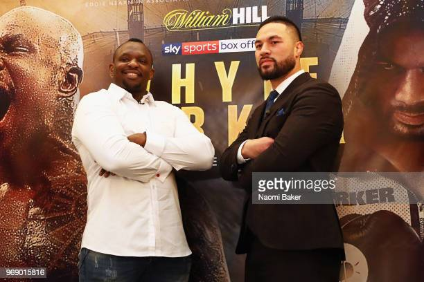 Dillian Whyte and Joseph Parker pose for photographs after the Dillian Whyte and Joseph Parker Press Conference at The Dorchester Hotel on June 7...