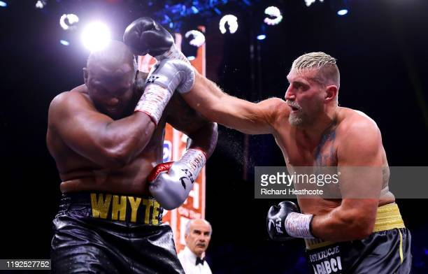 Dillian Whyte blocks a punch from Mariusz Wach during the Heavyweight fight between Dillian Whyte and Mariusz Wach during the Matchroom Boxing 'Clash...