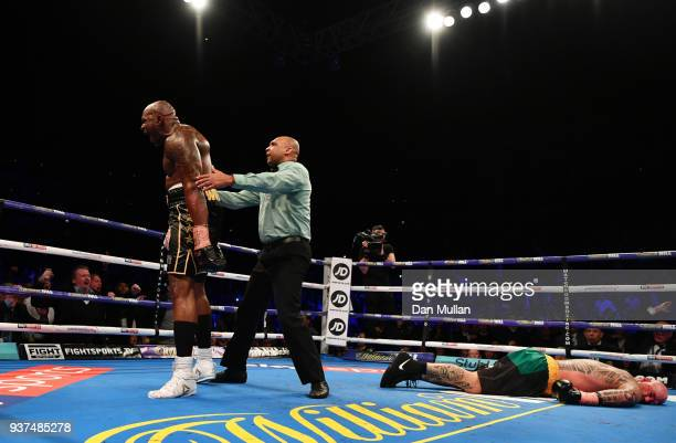Dillian Whyte celebrates as he knocks out Lucas Browne in the sixth round during their WBC Silver Heavyweight Championship at The O2 Arena on March...