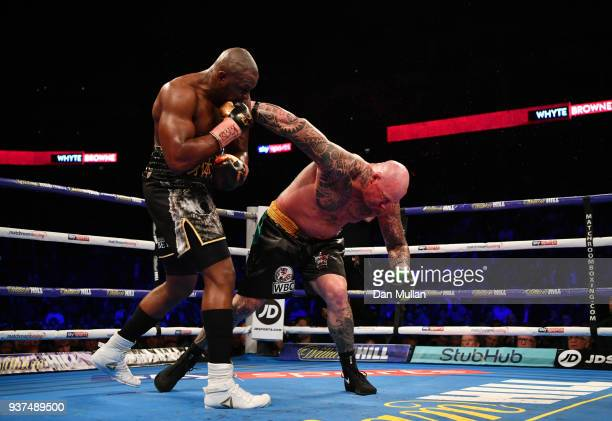 Dillian Whyte celebrates as he knocks out Lucas Browne in the sixth round for victory during their WBC Silver Heavyweight Championship at The O2...