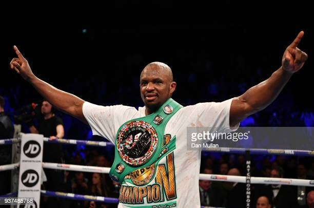 Dillian Whyte celebrates his sixth round knockout victory over Lucas Browne during their WBC Silver Heavyweight Championship at The O2 Arena on March...