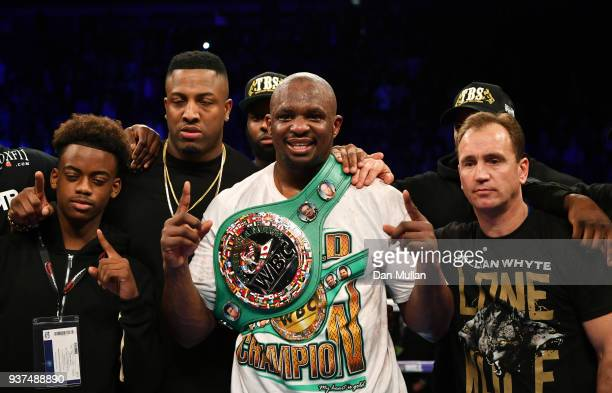 Dillian Whyte celebrates his sixth round knockout victory over Lucas Browne with this team after their WBC Silver Heavyweight Championship at The O2...