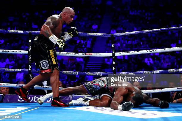 Dillian Whyte lays on the mat after being knocked down by Oscar Rivas in the 9th round during the WBC Interim Title and Final Eliminator for WBC...