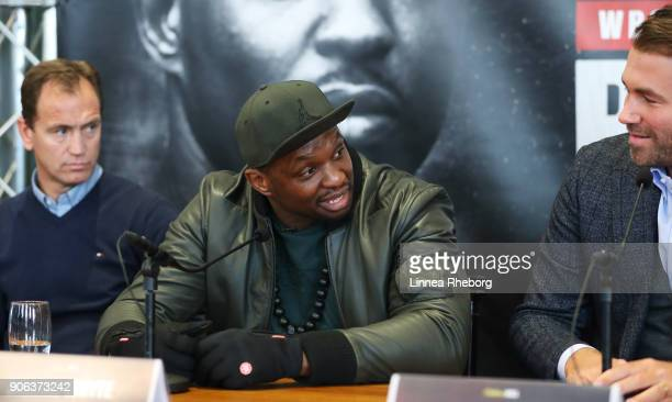 Dillian Whyte speaks alongside trainer Mark Tibbs and promoter Eddie Hearn during a press conference for the heavyweight fight between Dillian Whyte...