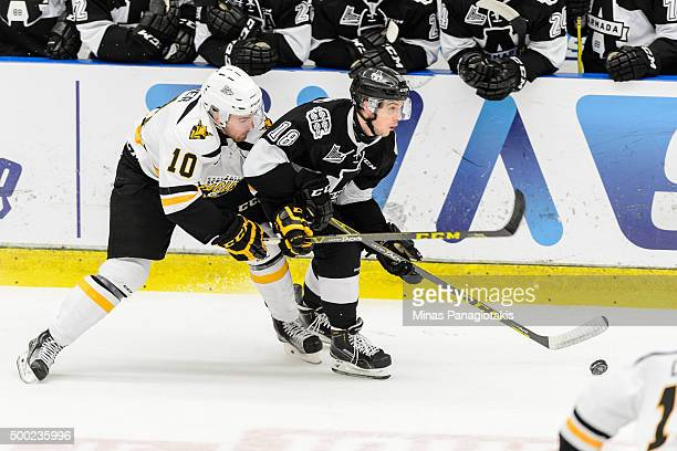 Dillon Boucher of the Cape Breton Screaming Eagles challenges Tyler Hylland of the BlainvilleBoisbriand Armada during the QMJHL game at the Centre...