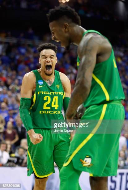 Dillon Brooks and Jordan Bell of the Oregon Ducks react in the second half against the Kansas Jayhawks during the 2017 NCAA Men's Basketball...