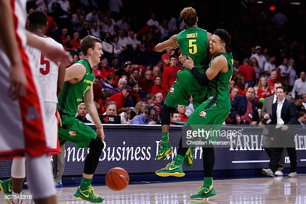 Dillon Brooks and Tyler Dorsey of the Oregon Ducks celebrate after defeating the Arizona Wildcats in the college basketball game at McKale Center on...