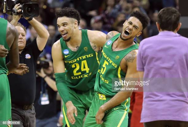 Dillon Brooks and Tyler Dorsey of the Oregon Ducks celebrate defeating the Kansas Jayhawks 7460 during the 2017 NCAA Men's Basketball Tournament...