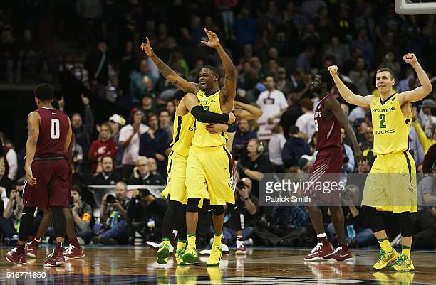 Dillon Brooks Elgin Cook and Casey Benson of the Oregon Ducks celebrate their 6964 win over the Saint Joseph's Hawks during the second round of the...