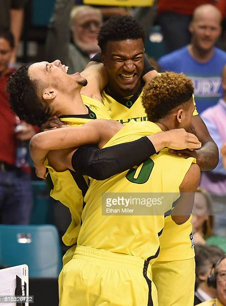 Dillon Brooks, Jordan Bell and Tyler Dorsey of the Oregon Ducks celebrate their 88-57 victory over the Utah Utes to win the championship game of the...