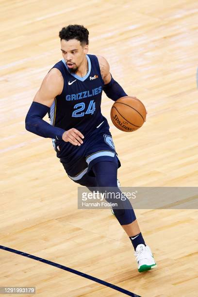 Dillon Brooks of the Memphis Grizzlies dribbles the ball against the Minnesota Timberwolves during the preseason game at Target Center on December...