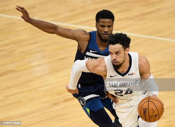 Dillon Brooks of the Memphis Grizzlies drives to the basket against Malik Beasley of the Minnesota Timberwolves during the fourth quarter of the game...