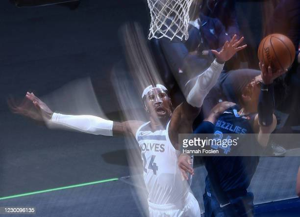 Dillon Brooks of the Memphis Grizzlies shoots the ball against Rondae Hollis-Jefferson of the Minnesota Timberwolves during the third quarter of the...