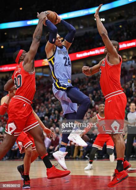 Dillon Brooks of the Memphis Grizzlies tries to drive between Noah Vonleh and Cristiano Felicio of the Chicago Bulls at the United Center on March 7...