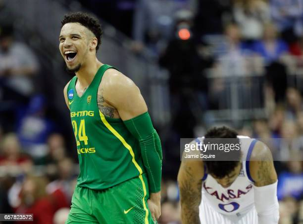 Dillon Brooks of the Oregon Ducks and Frank Mason III of the Kansas Jayhawks react in the second half during the 2017 NCAA Men's Basketball...