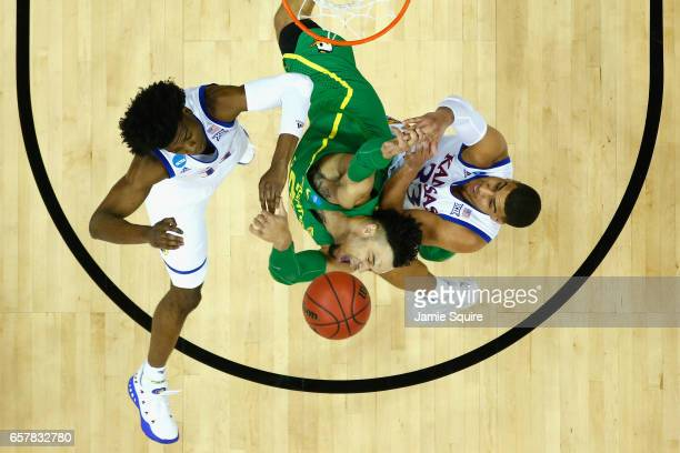 Dillon Brooks of the Oregon Ducks battles for the ball with Josh Jackson and Landen Lucas of the Kansas Jayhawks in the first half during the 2017...