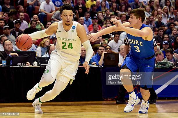 Dillon Brooks of the Oregon Ducks drives on Grayson Allen of the Duke Blue Devils in the first half in the 2016 NCAA Men's Basketball Tournament West...