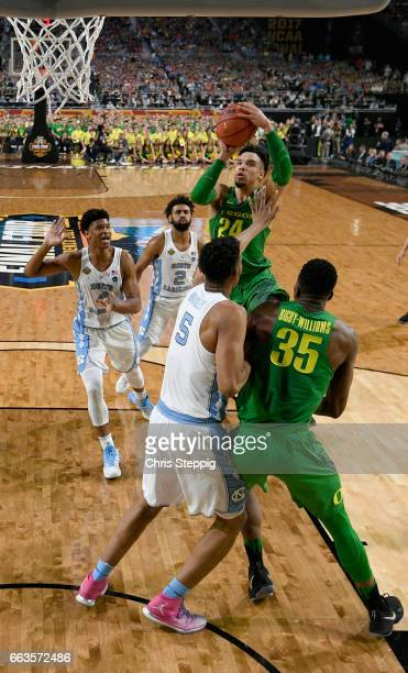 Dillon Brooks of the Oregon Ducks goes in for a jumpshot over Tony Bradley of the North Carolina Tar Heels during the 2017 NCAA Men's Final Four...