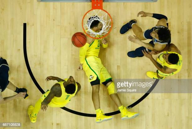 Dillon Brooks of the Oregon Ducks lies on the court during the game against the Michigan Wolverines in the 2017 NCAA Men's Basketball Tournament...