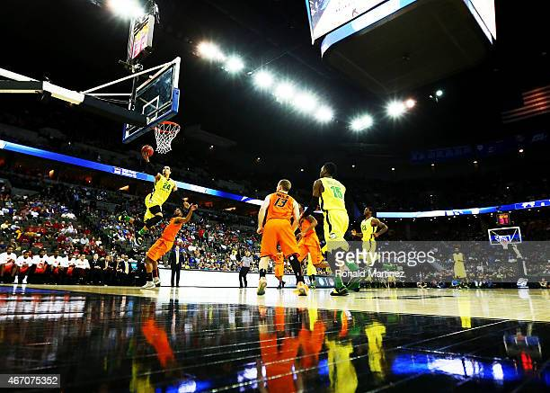 Dillon Brooks of the Oregon Ducks shoots over Jeff Newberry of the Oklahoma State Cowboys in the first half during the second round of the 2015 NCAA...