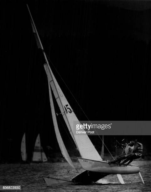 Dillon Dam Reservoir Mary Ford and Dan Zabel who won their class in the regatta are shown here hanging from trapezes to stabilize boat ***** Credit...