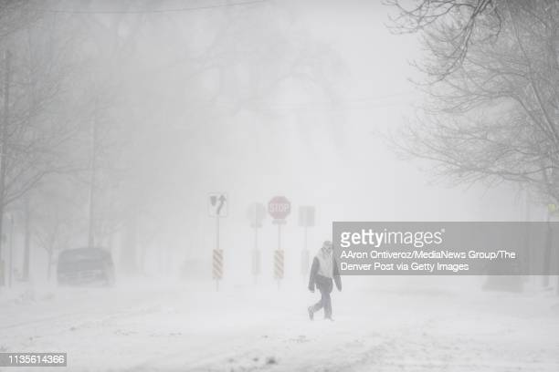 Dillon Dinter walks across 44th Avenue after leaving Berkeley Lake Park during a winter storm in the Denver metro area on Wednesday March 13 2019 The...
