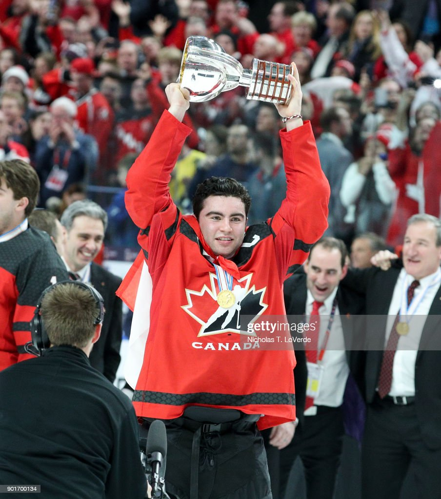 Dillon Dubé #9 of Canada raises the Championship trophy following Canada's 3-1 win over Sweden in the IIHF World Junior Championships Gold Medal game at KeyBank Center on January 5, 2018 in Buffalo, New York.