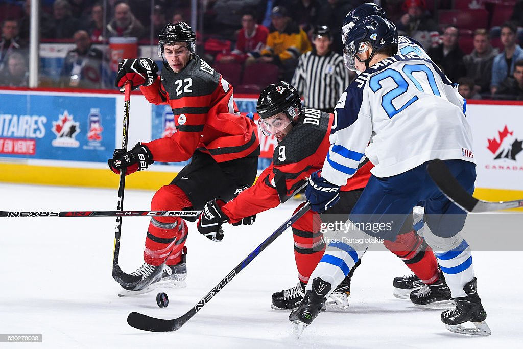 Dillon Dube #9 of Team Canada tries to skate the puck past Julius Mattila of Team Finland #20 during the IIHF exhibition game at the Bell Centre on December 19, 2016 in Montreal, Quebec, Canada. Team Canada defeated Team Finland 5-0.