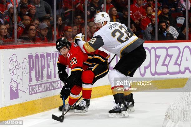 Dillon Dube of the Calgary Flames skates against Nick Holden of the Vegas Golden Knights during an NHL game on November 19 2018 at the Scotiabank...