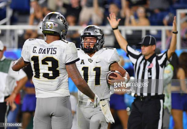 Dillon Gabriel of the UCF Knights celebrates with Gabriel Davis after scoring a touchdown in the second half against the Florida Atlantic Owls at FAU...