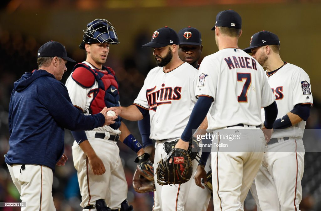 Dillon Gee #35 of the Minnesota Twins hands the ball to manager Paul Molitor #4 as he's pulled from the game against the Texas Rangers during the eighth inning of the game on August 3, 2017 at Target Field in Minneapolis, Minnesota. The Rangers defeated the Twins 4-1.