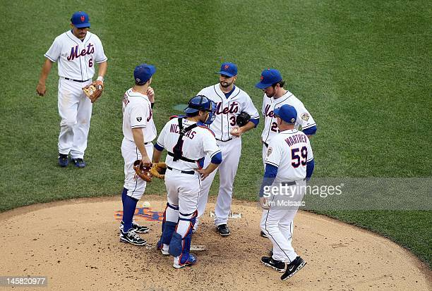 Dillon Gee of the New York Mets on the mound with pitching coach Dan Warthen against the St Louis Cardinals at Citi Field on June 4 2012 in the...