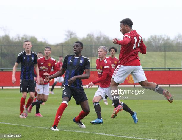 Dillon Hoogewerf of Manchester United U18s scores their second goal during the U18 Premier League match between Manchester United U18s and...