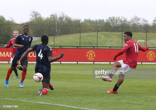 Dillon Hoogewerf of Manchester United U18s scores their third goal during the U18 Premier League match between Manchester United U18s and...