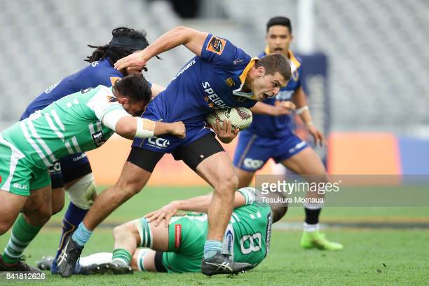 Dillon Hunt of Otago is tackled during the round three Mitre 10 Cup match between Otago and Manawatu on September 2 2017 in Dunedin New Zealand