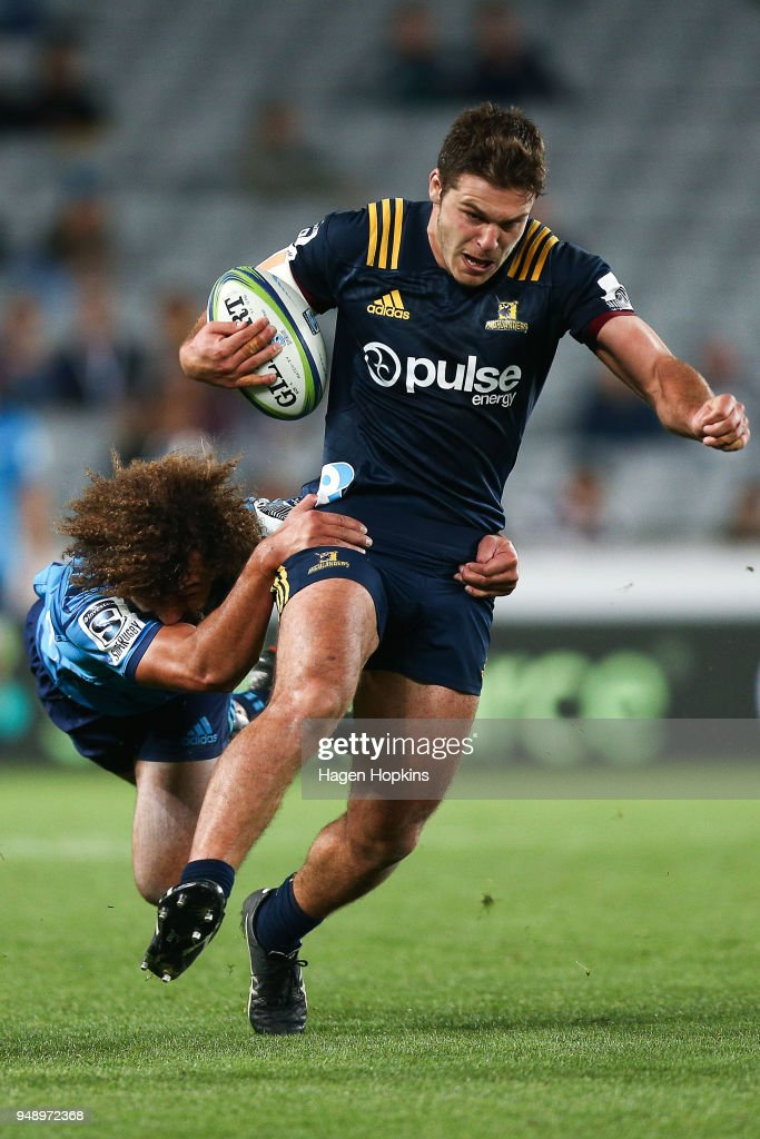 Dillon Hunt of the Highlanders is tackled by Orbyn Leger of the Blues during the round 10 Super Rugby match between the Blues and the Highlanders at Eden Park on April 20, 2018 in Auckland, New Zealand.