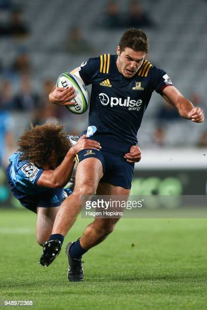 Dillon Hunt of the Highlanders is tackled by Orbyn Leger of the Blues during the round 10 Super Rugby match between the Blues and the Highlanders at...