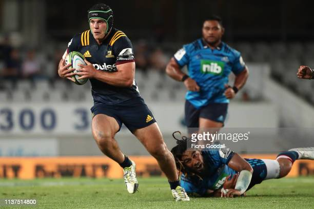 Dillon Hunt of the Highlanders makes a break during the round six Super Rugby match between the Blues and the Highlanders at Eden Park on March 22,...