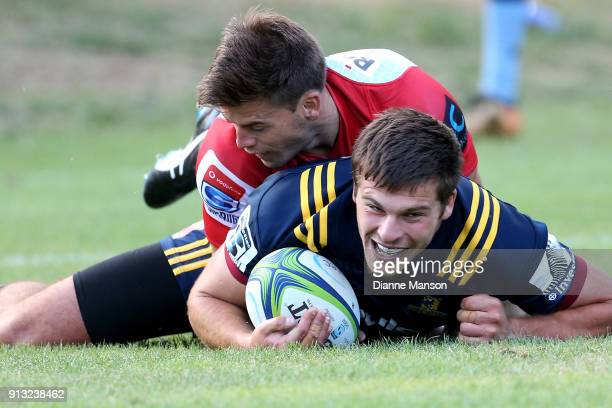 Dillon Hunt of the Highlanders scores a try during the Super Rugby preseason match between the Highlanders and the Waratahs on February 2 2018 in...