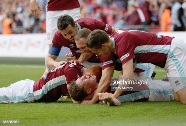 Dillon Morse of South Shields clebrates scoring his teams second goal with teammates during the Buildbase FA Vase Final between South Shields and...