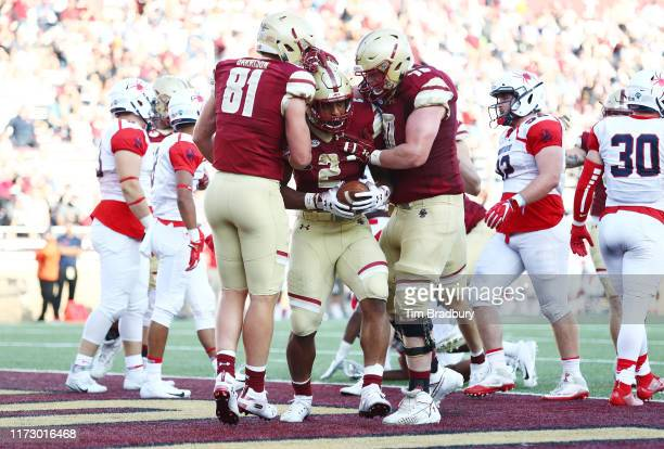 Dillon of the Boston College Eagles celebrates with teammates after scoring a touchdown during the second half against the Richmond Spiders at Alumni...