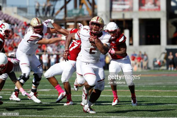 Dillon of the Boston College Eagles rushes for an 11yard touchdown in the fourth quarter of a game against the Louisville Cardinals at Papa John's...