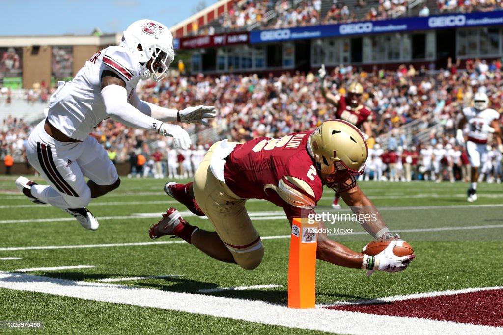 AJ Dillon #2 of the Boston College Eagles scores a touchdown past Brice McAllister #2 of the Massachusetts Minutemen at Alumni Stadium on September 1, 2018 in Chestnut Hill, Massachusetts.