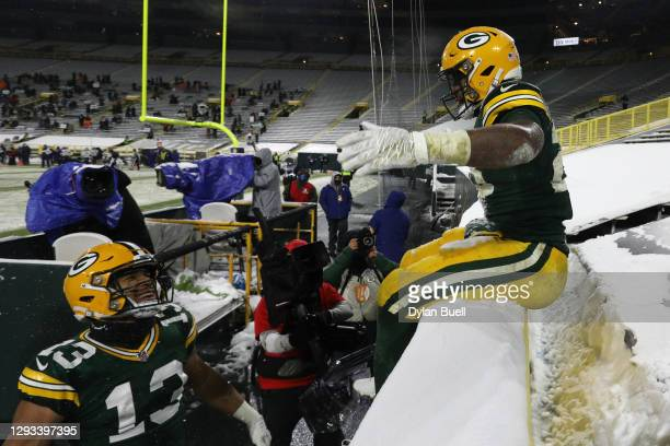 Dillon of the Green Bay Packers does the Lambeau Leap after scoring a touchdown against the Tennessee Titans during the fourth quarter at Lambeau...