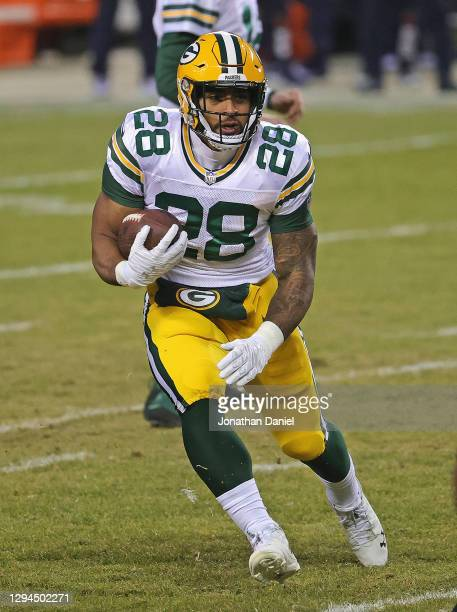 Dillon of the Green Bay Packers runs against the Chicago Bears at Soldier Field on January 03, 2021 in Chicago, Illinois. The Packers defeated the...