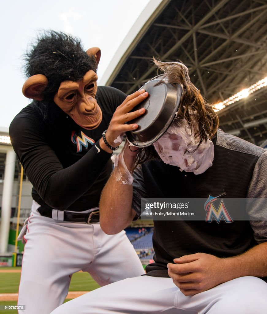Dillon Peters #76 of the Miami Marlins gets a pie in the face from the monkey after the game against the Chicago Cubs at Marlins Park on April 1, 2018 in Miami, Florida.