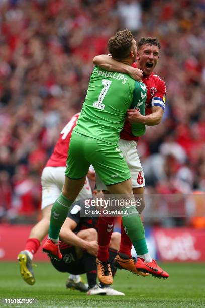 Dillon Phillips and Jason Pearce of Charlton Athletic celebrate victory at the final whistle during the Sky Bet League One Playoff Final match...
