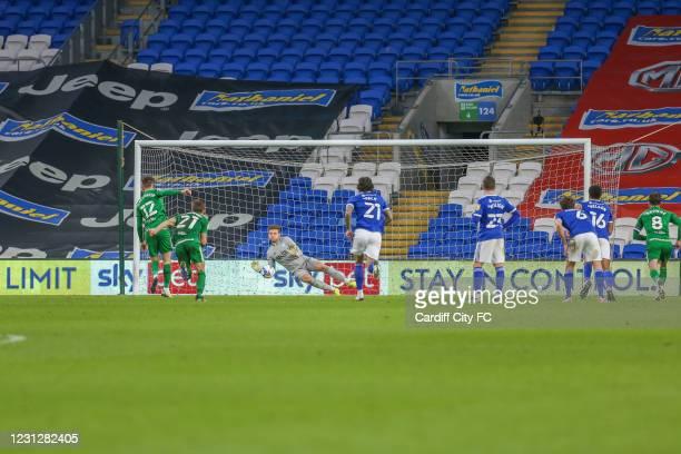 Dillon Phillips of Cardiff City FC saves a penalty kick from Paul Gallagher of Preston North End during the Sky Bet Championship match between...