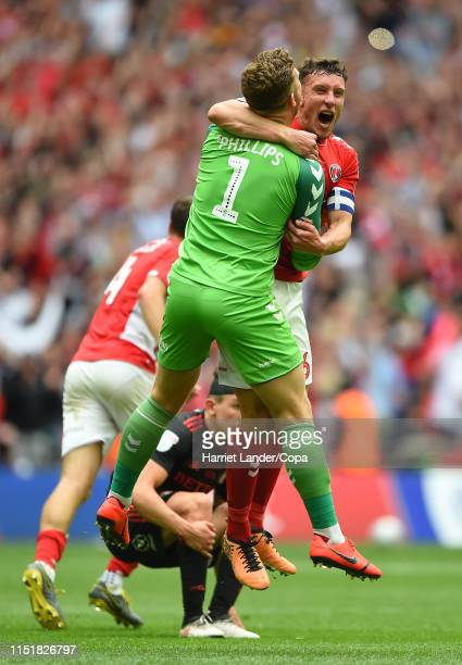 Dillon Phillips of Charlton Athletic and Jason Pearce of Charlton Athletic celebrate following their team's victory in the Sky Bet League One Playoff...