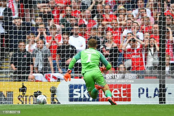 Dillon Phillips of Charlton Athletic scrambles the ball leading to Sunderland's first goal during the Sky Bet League One Playoff Final match between...